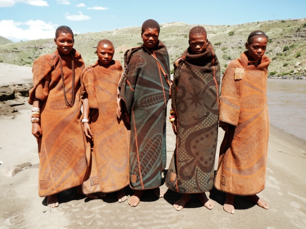 Basotho boys clothed in traditional blankets and decorated for their initiation into manhood.